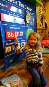 Child practicing their letters and numbers on the learning chart