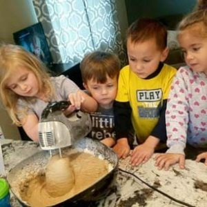 Kids mixing cookies for a USDA approved breakfast
